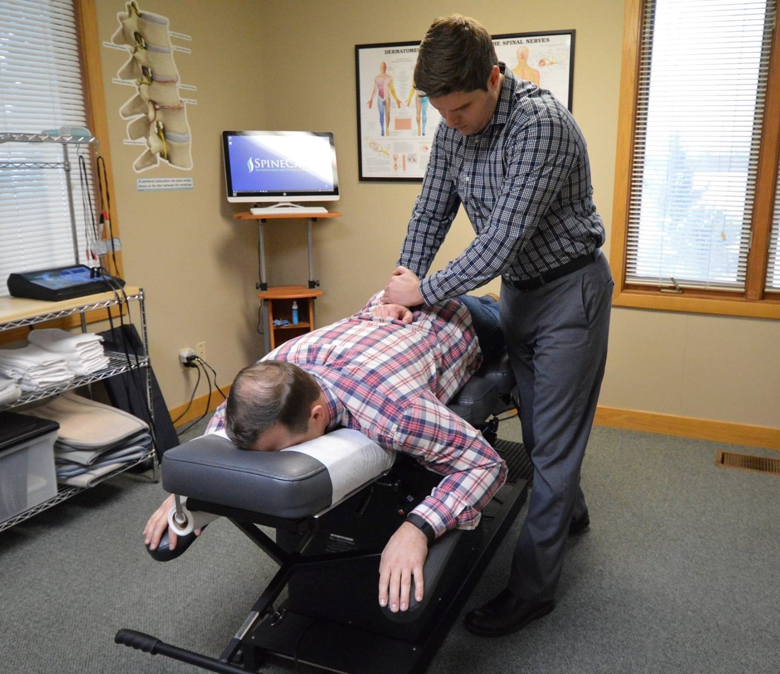 Dr. Rowe giving chiropractic adjustment